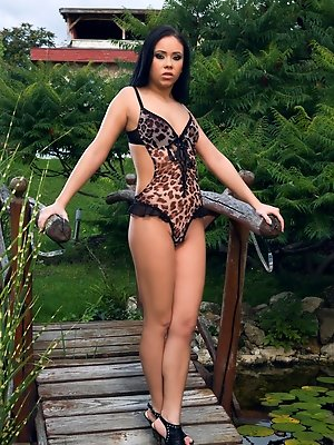 Exotic petite beauty fucked hard in the garden by a big guy
